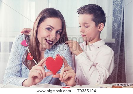 Happy Valentines Day, Mother day or Woman 8 march Day. Young boy spend time with his mum and celebrate it
