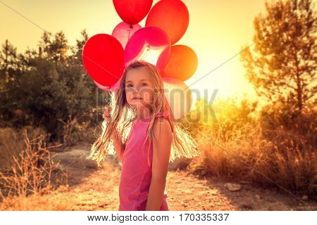 portrait if little girl with balloons