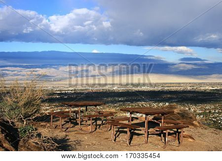 Picnic tables on a hill side overlooking Palm Springs, CA