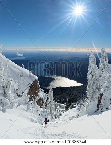 A Woman Hiker Descending A Snowy Mountain.  Mt Ellinor, Olympic National Park, Washington.
