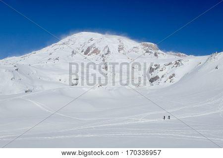 Two Snowshoers on Mt Rainier.  Cascade Mountains, Washington