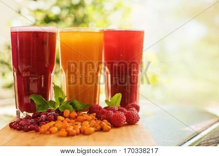 set of fruit non-alcoholic drink with cranberries raspberries and sea buckthorn