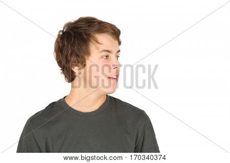 Boy teenager in grey t-shirt looks away isolated on white background