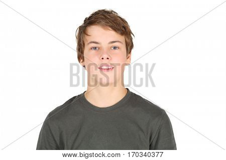 Boy teenager in grey t-shirt smiles isolated on white background