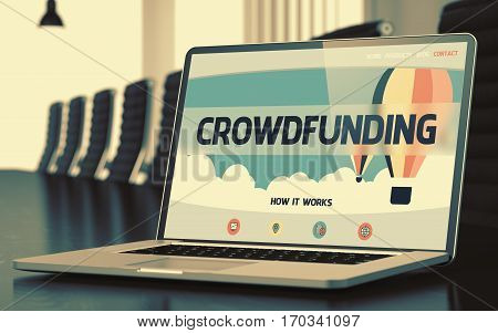 Modern Conference Room with Laptop Showing Landing Page with Text Crowdfunding. Closeup View. Toned Image with Selective Focus. 3D.