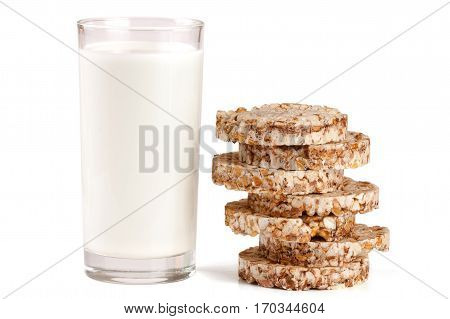 glass of milk with grain crispbreads isolated on a white background.
