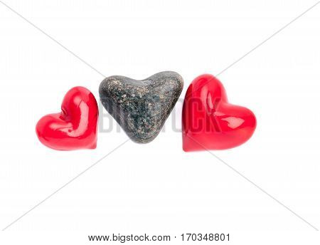 Collection of hearts from of stone and glass material closeup isolated on white background