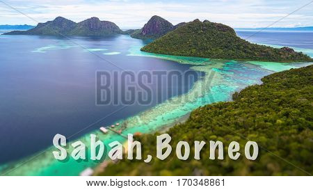 Sabah,Borneo quote concept with Tropical paradise island with bright smooth mirror sand & crystal clear water with rocky shore in the island of Semporna, Borneo, ideal for print card and poster design.