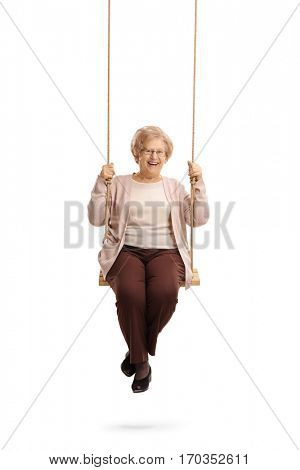 Happy elderly woman on a swing isolated on white background