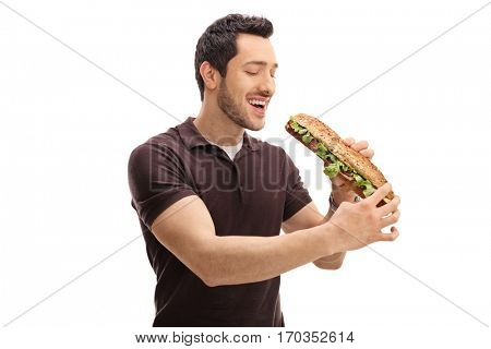 Young man having a sandwich isolated on white background