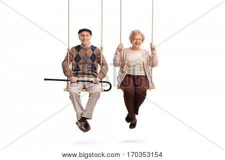 Elderly man and an elderly woman sitting on swings isolated on white background