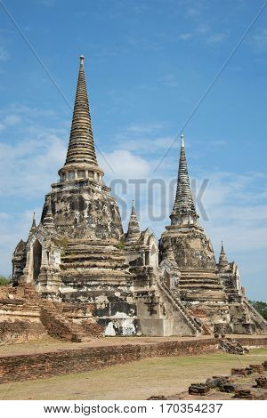 Two ancient Buddhist stupas of Wat Phra Si Sanphet in historic park of the city of Ayutthaya, Thailand