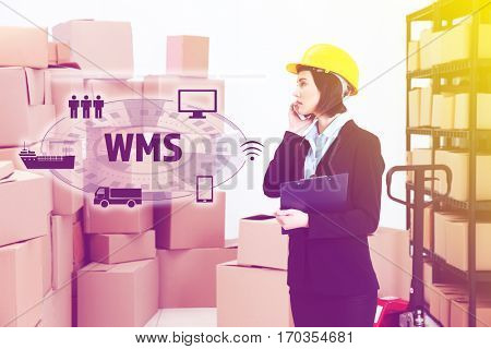 Warehouse management system concept. Woman working at factory facility