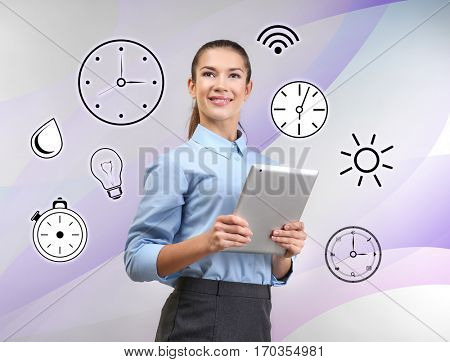 Business and time management concept. Young woman with tablet on colorful background