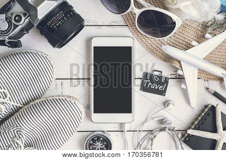 Overhead view of Traveler's accessories items and cellphone with copy space Travel concept