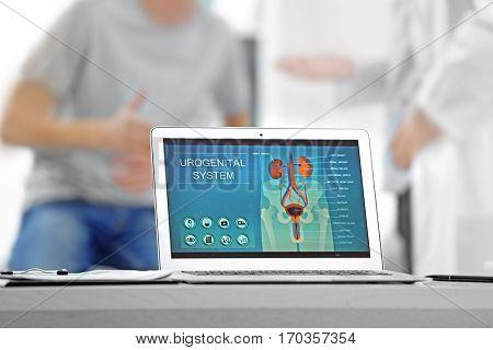 Medical concept. Laptop with urology image on doctor's desk
