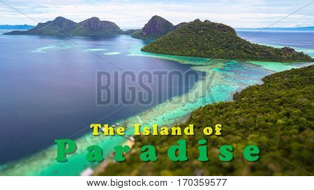 The Island Of Paradise quote concept with Tropical paradise island with bright smooth mirror sand & crystal clear water with rocky shore in the island of Semporna, Borneo, ideal for print card and poster design.