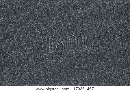 abstract speckled texture and background of textile material or fabric of dark silvery color
