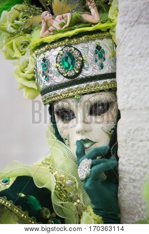 VENICE, ITALY - FEBRUARY 27, 2016: Unidentified person with Venetian Carnival mask in Venice, Italy on February 2016. 