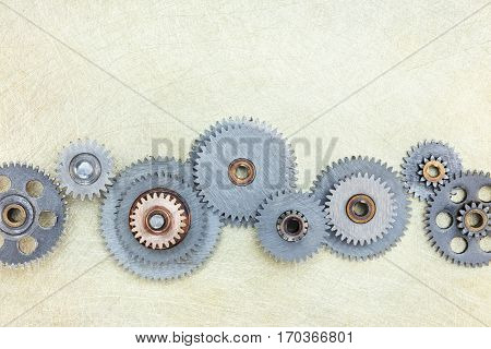 Different Metal Gear Cogwheels On Scratched Brass Background