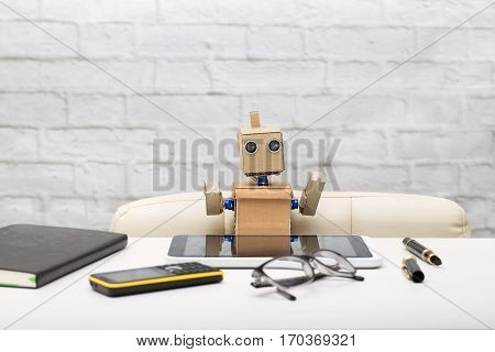 Robot writes in the course of work diary pen tablet