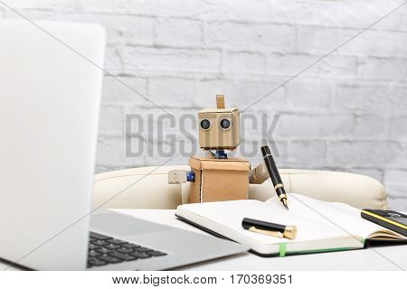 Robot working at a desk. the working process