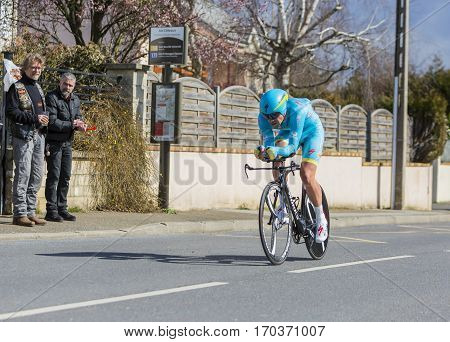 Conflans-Sainte-HonorineFrance-March 62016: The Kazakh cyclist Dmitriy Gruzdev of Astana Team riding during the prologue stage of Paris-Nice 2016.