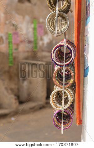 close up of hanging display of art crafts bangle in shopfront at Pushkar Rajasthan India.