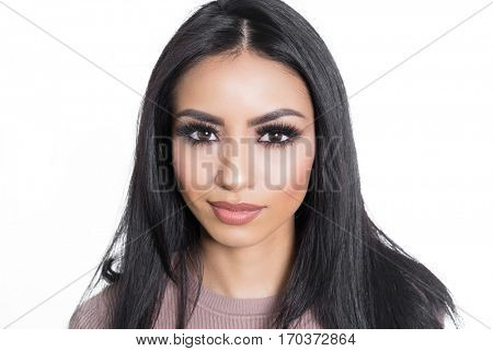 Beautiful face of woman with dark hair