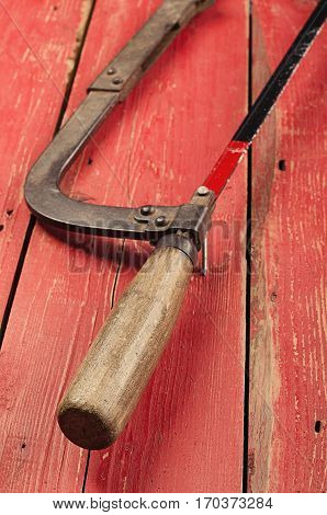 Tools. Hacksaw  On Wooden Background. Ready To Work.