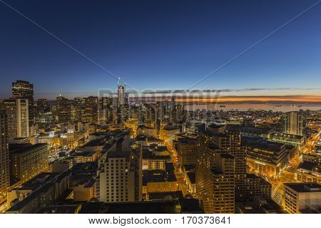 San Francisco, California, USA - January 14, 2017:  Predawn glow behind downtown towers and Mission Bay district.