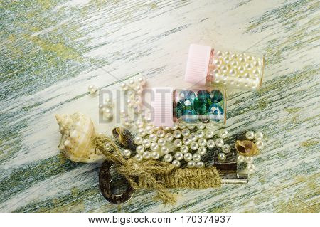Scattered Pearls And Old Key And Jars With Pearls And Blue Beads.