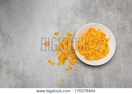 Corn Flakes In A Bowl On Concrete Table