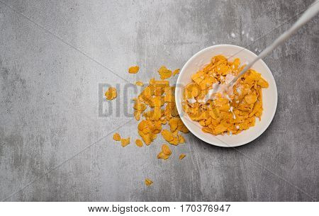 Corn Flakes Cereal With Milk In A Bowl On A Concrete Table