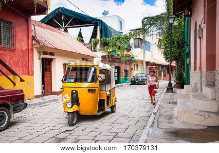 FLORES, GUATEMALA- DEC 22, 2015:  Taxi tuk-tuk at the street of Flores on Dec 22, 2015, Guatemala.