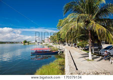 FLORES, GUATEMALA-DEC 22, 2015: Panoramic view at Peten Iitza lake in Flores on Dec 20, 2015. Guatemala.