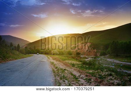 Orange sunset on the road in Western Tien-Shan, Uzbekistan