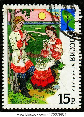 GOMEL, BELARUS, 1 FEBRUARY 2017, Stamp printed in Russia shows image of A sarafan is a long, trapezoidal traditional Russian jumper dress (pinafore) worn as Russian folk costume by women, circa 2012.
