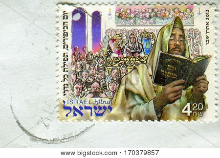 GOMEL, BELARUS, 1 FEBRUARY 2017, Stamp printed in Israel shows image of the Rabbi reading the Torah, circa 2012.