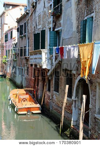 Venice Italy  Clothes Hanging And Doors Of The Houses Directly O