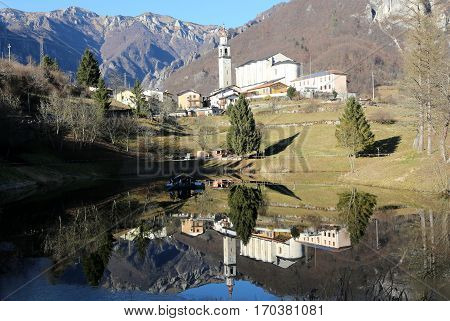 the smallest municipality of Italy called LAGHI with the little lake and the church with steeple
