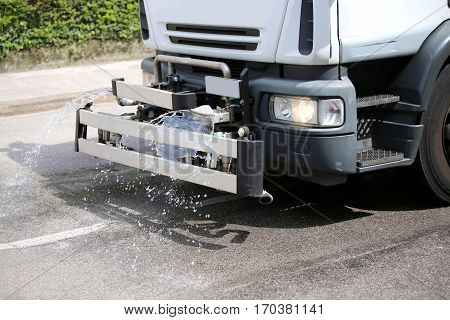 Tank Truck With Cister For Cleaning The Street In The City With