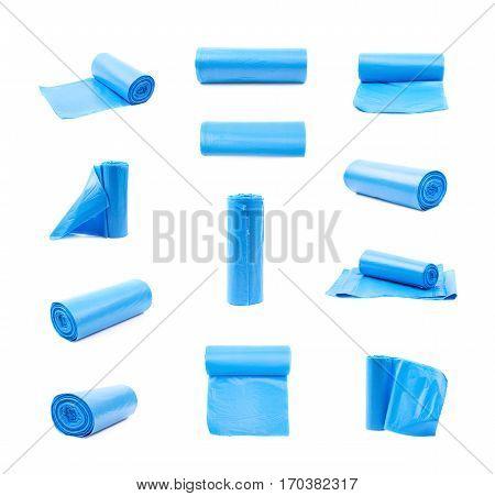 Blue plastic polyethylene trash bag roll isolated over the white background, set of multiple different foreshortenings
