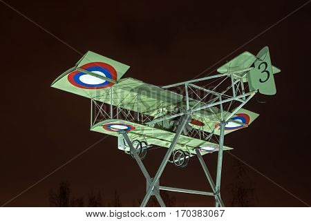 Gatchina Russia - February 10 2016: Fragment of the monument in honor of the 100th anniversary of the first military airport in Russia. Airplane Model Foreman. Night Photography.