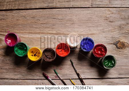 Different Colour Paint On The Wooden Background