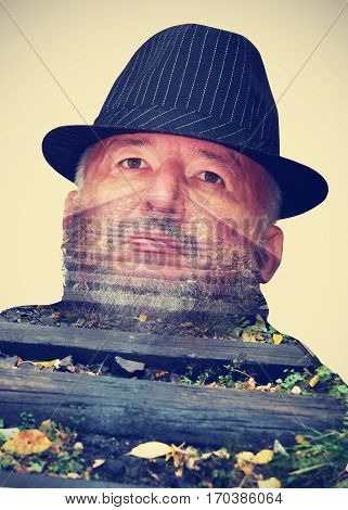 Railway on the background of man's face. Collage. Double exposure