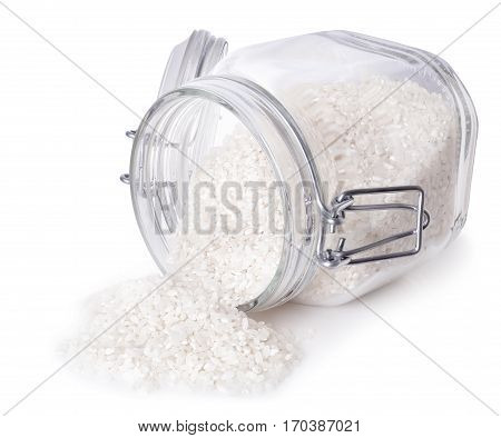 Raw rice in a jar isolated on white background. White uncooked rice scattered out of glass transparent container