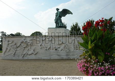 A view of a winged statue in gardens in Copenhagen