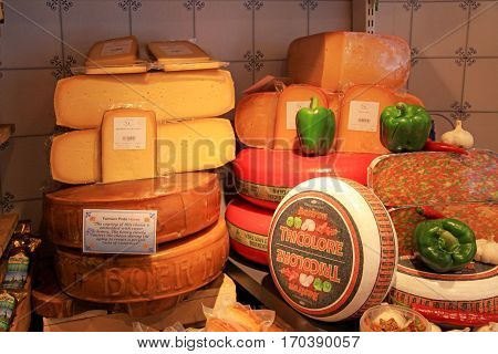 AMSTERDAM, NETHERLANDS - MAY 3, 2016: Display of traditional Dutch cheese like Edam and Gouda cheese on a table at local cheese shop, Amsterdam, the Netherlands
