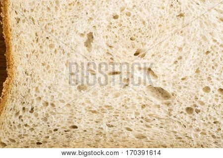 Slice Of Bread On An Old Cutting Board Background